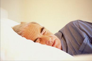 old man sleepingin bed